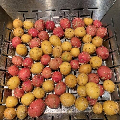 grilled baby potatoes put in vegetable grill pan